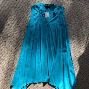 Long sleeveless flared summer shirt